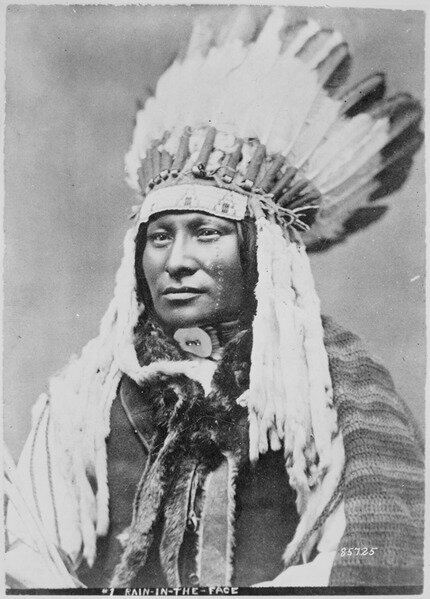 lossy-page1-430px-Rain-in-the-Face,_a_Hunkpapa_Sioux,_bust-length,_full-face,_wearing_feathered_headdress_-_NARA_-_530895.tif.jpg